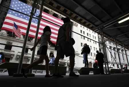 Morning commuters walk past the New York Stock Exchange August 20, 2012. REUTERS/Brendan McDermid