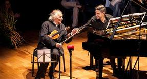 Violinist Ivry Gitlis and Pianist Jose Gallardo perform a Debussy duet during the Kaposvar International Chamber Music Festival, also known as Kaposfest, at the Szivarvany Theatre in Kaposvar August 14, 2012. This picturesque southwestern Hungarian city, flanked by rolling hills and cornfields parched by a heat wave, is more famous for painters and playhouses than musicians, but this month it was one of the stars of the chamber music universe. REUTERS/Zsolt Lefferton/Courtesy of Kaposvar International Chamber Music Festival/Handout