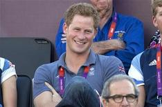 Britain's Prince Harry watches the women's beach volleyball bronze medal match between Brazil and China at Horse Guards Parade during the London 2012 Olympic Games August 8, 2012. REUTERS/Neil Hall