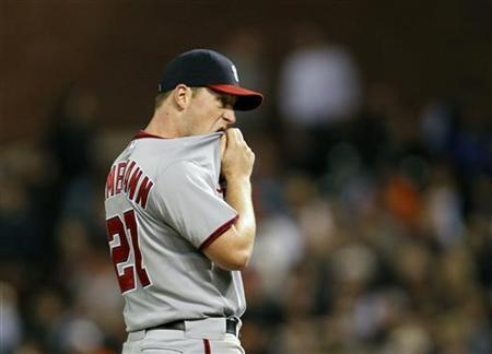 Washington Nationals starting pitcher Jordan Zimmermann reacts after yielding a run scoring single to San Francisco Giants Brandon Belt during the sixth inning of the MLB baseball game in San Francisco, California August 14, 2012. REUTERS/Robert Galbraith