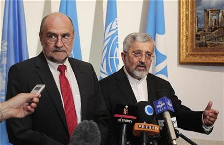 International Atomic Energy Agency (IAEA)'s chief inspector Herman Nackaerts and Iran's IAEA ambassador Ali Asghar Soltanieh (R) brief the media after a meeting at the Iranian embassy in Vienna August 24, 2012. REUTERS/Herwig Prammer