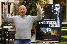 """Director Tony Scott poses during a photocall to promote his lastest film """"The Taking of Pelham 123"""" in Paris July 20, 2009. REUTERS/Benoit Tessier"""