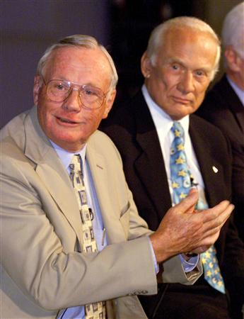 Apollo 11 astronauts Neil Armstrong (L) and Buzz Aldrin talk about the launch of Apollo 11 on the 30th anniversary of the event at the Kennedy Space Center in this July 16,1999, file photo. REUTERS/Joe Skipper/Files