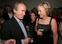 """Novelist Martin Amis (L) talks to Tina Brown at the launch of Brown's book """"The Diana Chronicles"""" at a party hosted by Reuters in the Serpentine Gallery in central London, June 18, 2007. REUTERS/Paul Hackett"""