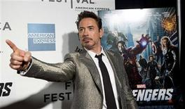 """Robert Downey Jr. poses as he arrives at the screening of the film """"Marvel's The Avengers"""" for the closing night of the 2012 Tribeca Film Festival in New York in this April 28, 2012 file photo. REUTERS/Andrew Kelly/Files"""
