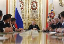 Russian President Vladimir Putin (C) speaks during a budget meeting with senior government officials in Moscow's Kremlin June 28, 2012. REUTERS/Sergei Karpukhin