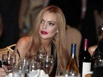 Atriz Lindsay Lohan comparece ao jantar anual da associação dos correspondentes da Casa Branca, em Washington, nos EUA. Lohan está sendo procurada pela polícia de Los Angeles para depor sobre um roubo de joias na casa de um amigo, afirmou o jornal Los Angeles Times nesta terça-feira, citando fontes de segurança. 28/08/2012 REUTERS/Larry Downing