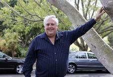 Controversial billionaire Clive Palmer poses for pictures at his golf resort and spa in Coolum, Sunshine Coast August 21, 2012. REUTERS/Jim Reagan