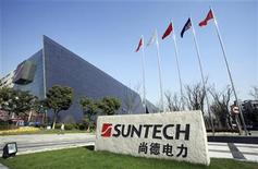 A man walks past Suntech Power Holdings headquarters in Wuxi, Jiangsu province March 26, 2010.REUTERS/Stringer