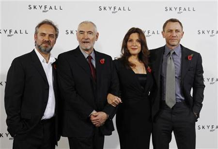 Director Sam Mendes (L) and actor Daniel Craig (R) pose with producers Barbara Broccoli and Michael G. Wilson (2nd L) during a photocall to launch the start of production of the new James Bond film ''SkyFall'' at a restaurant in London November 3, 2011. REUTERS/Luke MacGregor/Files