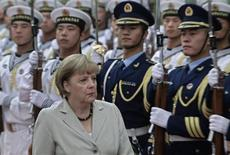 German Chancellor Angela Merkel inspects an honour guard during an official welcoming ceremony at the Great Hall of the People in Beijing August 30, 2012. Merkel makes her second trip to China in half a year this week, hoping to strengthen booming trade ties and obtain assurances from Beijing that it will support the fragile euro zone by buying the bonds of its stricken southern members. REUTERS/Jason Lee