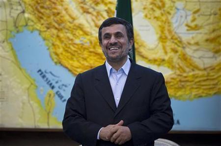 Iranian President Mahmoud Ahmadinejad jokes with journalists in Tehran March 4, 2012. REUTERS/Caren Firouz/Files