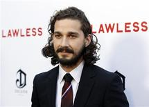 """Cast member Shia LaBeouf poses at the premiere of the film """"Lawless"""" in Los Angeles August 22, 2012. REUTERS/Danny Moloshok"""