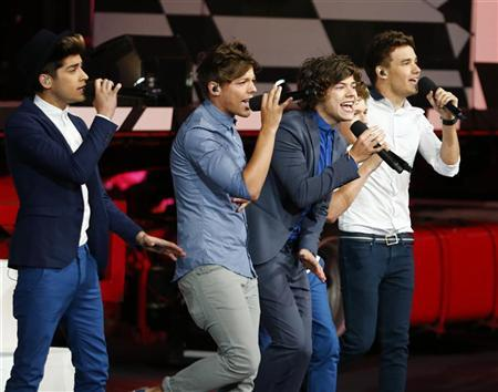 One Direction performs at the closing ceremony of the London 2012 Olympic Games at the Olympic stadium August 12, 2012. REUTERS/Kai Pfaffenbach