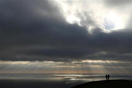 Two girls walk on a hill during sunset in Vina del Mar city, about 75 miles (120 km) northwest of Santiago, August 11, 2007. REUTERS/Eliseo Fernandez/Files