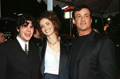 """Sage Stallone, (L) appears at the premier for """"Daylight"""" with Amy Brenneman and his father Sylvester Stallone (R) in Los Angeles in this December 5, 1996 file photo. Sage Stallone was found dead July 13, 2012 at his home in Hollywood, authorities and his attorney said. Police said there was no sign of forced entry or foul play. REUTERS/Fred Prouser/Files."""