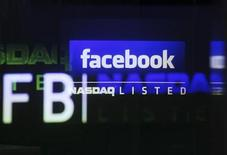 The Facebook logo is seen on a screen inside at the Nasdaq Marekstsite in New York May 18, 2012. REUTERS/Shannon Stapleton
