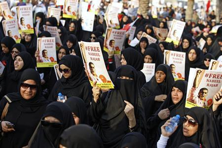 Protesters holding posters of Nabeel Rajab and other political prisoners march on the highway during an anti-government protest organised by al-Wefaq opposition party in Budaiya, west of Manama, Bahrain August 31, 2012. REUTERS-Hamad I Mohammed