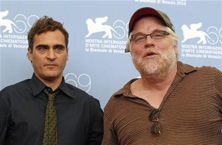 U.S. actors Philip Seymour Hoffman (R) and Joaquin Phoenix pose during a photocall for the movie ''The Master'' at the 69th Venice Film Festival September 1, 2012. REUTERS/Tony Gentile