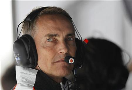 McLaren Formula One team principal Martin Whitmarsh looks from the pit wall during the qualifying session of the Chinese F1 Grand Prix at Shanghai International circuit April 14, 2012. REUTERS/Aly Song