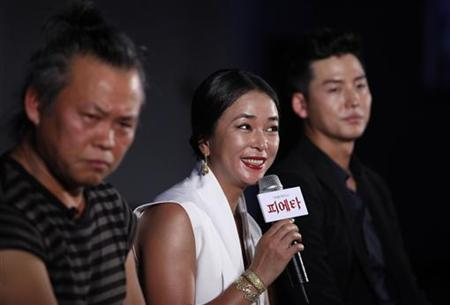 (L-R) South Korean director Kim Ki-duk, actress Jo Min-soo and actor Lee Jeong-jin attend a production report conference of their new movie ''Pieta'', in Seoul July 19, 2012. REUTERS/Kim Hong-Ji