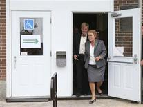 Parti Quebecois leader Pauline Marois walks out of the polling station with her husband Claude Blanchet following her vote in her home riding in Beaupre, Quebec, September 4, 2012. REUTERS/Christinne Muschi