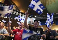 Supporters of Parti Quebecois leader Pauline Marois cheer as they watch the results come in from the Quebec provincial election in Montreal, Quebec, September 4, 2012. REUTERS/Christinne Muschi