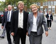 Parti Quebecois leader Pauline Marois (R) smiles as she walks with her husband Claude Blanchet following her vote in her home riding in Beaupre, Quebec, September 4, 2012. Quebecers are voting in a provincial election on Tuesday. REUTERS/Christinne Muschi