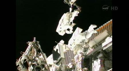 ISS Expedition 32 flight engineers Sunita Williams of NASA and Akihiko Hoshide of the Japan Aerospace Exploration Agency perform a spacewalk to complete an equipment installation outside the International Space Station in this NASA video image captured on September 5, 2012. REUTERS/NASA TV/Handout