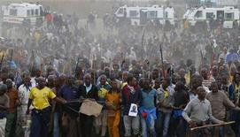 Mineworkers take part in a march at Lonmin's Marikana mine in South Africa's North West Province, September 5, 2012. REUTERS/Mike Hutchings