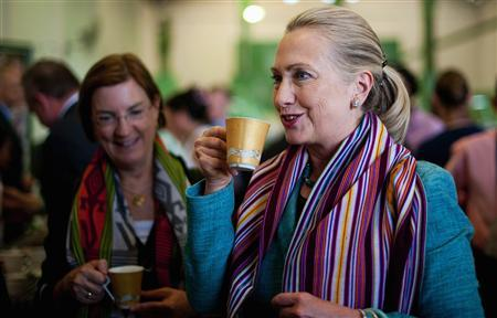 U.S. Secretary of State Hillary Clinton (R) drinks a cup of coffee as she tours the Timor Coffee Cooperative in Dili September 6, 2012. REUTERS/Jim Watson/Pool