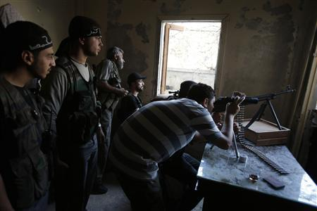A Free Syrian Army sniper takes up position in the Seif El Dawla neighbourhood of Aleppo in this September 2, 2012 file photo. REUTERS/Youssef Boudlal/Files