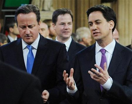 Prime Minister David Cameron (L) listens to opposition leader Ed Miliband as they process to the House of Lords to listen to the Queen's Speech during the State Opening of Parliament in central London May 9, 2012. REUTERS/Stefan Rousseau/Pool