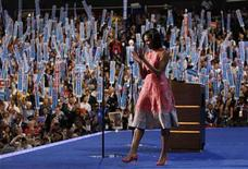 U.S. first lady Michelle Obama applauds after concluding her address to delegates during the first session of the Democratic National Convention in Charlotte, North Carolina, September 4, 2012. REUTERS/Jessica Rinaldi