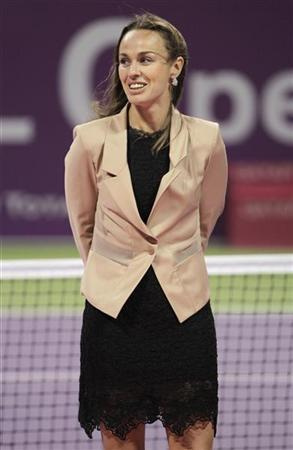 Former tennis champion Martina Hingis attends the final match at the Qatar Open tennis tournament in Doha February 19, 2012. REUTERS/Fadi Al-Assaad