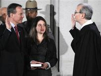 New York Attorney General Eric Schneiderman (L) is sworn in by Chief Judge Jonathan Lippman during a ceremony at the Capitol in Albany, New York, January 1, 2011. Schneiderman's daughter Catherine is at center. REUTERS/Mike Groll/Pool