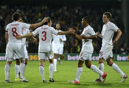England's Leighton Baines (3) celebrates his goal against Moldova with team mates during their World Cup 2014 qualifying soccer match at the Zimbru stadium in Kishinev, September 7, 2012. REUTERS/Nigel Roddis
