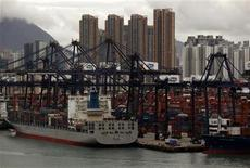 Highrise residential buildings are seen behind container terminals at Hong Kong's Kwai Chung district September 7, 2012. REUTERS/Bobby Yip