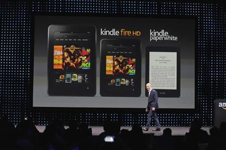 Amazon CEO Jeff Bezos walks off after unveiling the Kindle Paperwhite, Kendle Fire HD 8.9'' and 7'' during Amazon's Kindle Fire event in Santa Monica, California September 6, 2012. REUTERS/Gus Ruelas