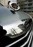 """<p>Renault Samsung, la filiale sud-coréenne de la marque au losange prévoit de supprimer quelque 15% de ses effectifs dans le cadre d'un """"plan de départs à la retraite volontaires"""" destiné à réduire les coûts. /Photo d'archives/REUTERS/Kim Kyung-Hoon</p>"""