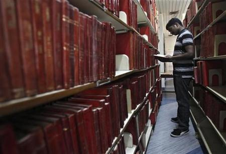 A Master of Business Administration (MBA) student looks at a book in a library at the Management Development Institute (MDI) in Gurgaon, on the outskirts of New Delhi May 2, 2012. REUTERS/Adnan Abidi/Files