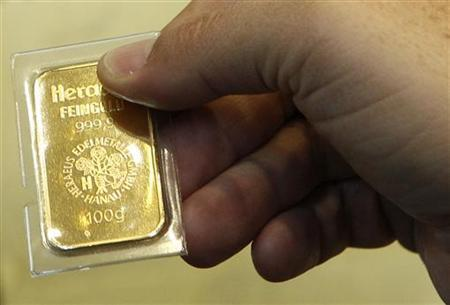 A Man Holds 250 Gram 8 81 Ounces Gold Bar After The Unveiling Of