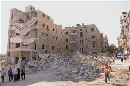 Damaged buildings are seen after an explosion on Sunday ripped through the northern Syrian city of Aleppo September 10, 2012. The explosion killed 17 people and wounded 40, the official Syrian state news agency said. .REUTERS/George Ourfalian