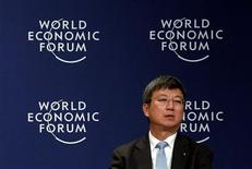 Zhu Min, International Monetary Fund (IMF) deputy managing director, speaks during a meeting at the World Economic Forum (WEF) in the Chinese port city of Tianjin September 11, 2012. The euro zone debt crisis still has a long way to go before it ends and it is key that Europe retains its faith in the single currency, Zhu said on Tuesday. He added that it was important not to underestimate the impact Europe's crisis was having on the global economy. REUTERS/David Gray