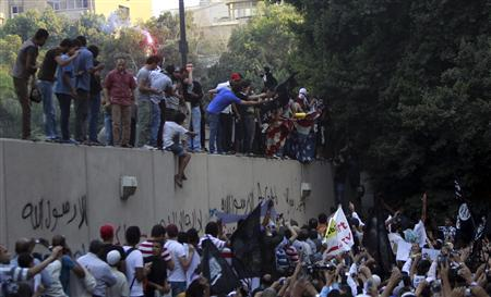 Protesters destroy an American flag pulled down from the U.S. embassy in Cairo September 11, 2012. REUTERS/Amr Abdallah Dalsh