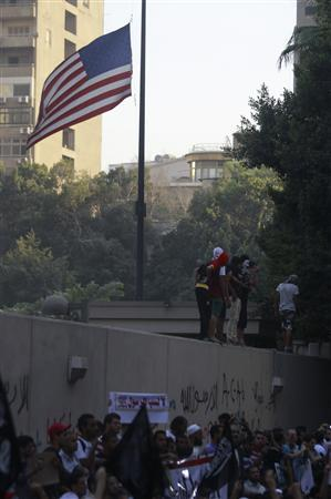 Protesters shout slogans near an American flag in front of the U.S. embassy in Cairo September 11, 2012. REUTERS/Amr Abdallah Dalsh