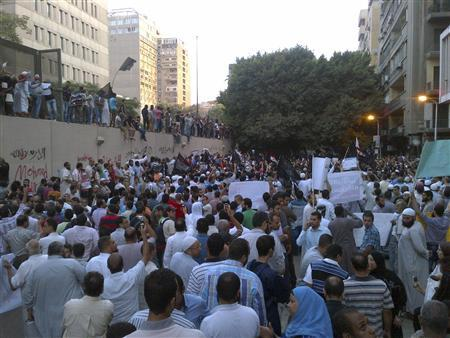 People attend a rally in front of the U.S. embassy to protest against a recently produced movie insulting Prophet Mohammad, in Cairo September 11, 2012. REUTERS/Amr Abdallah Dalsh
