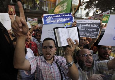People shout and hold slogans in front of the U.S. embassy during a protest in Cairo September 11, 2012. REUTERS/Mohamed Abd El Ghany