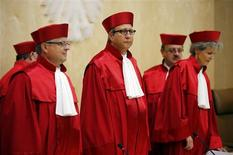 President of the German Constitutional Court (Bundesverfassungsgericht ) Andreas Vosskuhle (C) arrives with other judges to give the ruling on the European Stability Mechanism (ESM) in Karlsruhe September 12, 2012. REUTERS/Kai Pfaffenbach