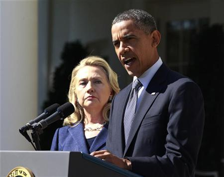 U.S. President Barack Obama delivers a statement alongside Secretary of State Hillary Clinton, following the death of the U.S. Ambassador to Libya, Chris Stevens, and others, from the Rose Garden of the White House in Washington, September 12, 2012. REUTERS/Jason Reed